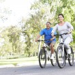 Stock Photo: Senior Couple Cycling In Park