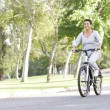 Senior Woman Cycling In Park — Stock Photo