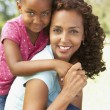 Stock Photo: Portrait Of Mother And Daughter In Park