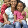 Mother With Children In Park — Stock Photo #4822528