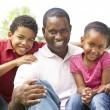 Father With Children In Park — Stock Photo #4822558