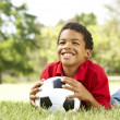 Stock Photo: Boy In Park With Football