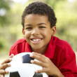 Boy In Park With Football — Stock Photo