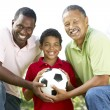 Royalty-Free Stock Photo: Grandfather With Son And Grandson In Park With Football