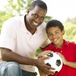 Father And Son In Park With Football — Stock Photo