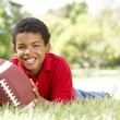 Boy In Park With AmericFootball — Stock Photo #4822655