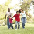 Family Enjoying Walk In Park — Stock Photo #4822693