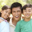 Father With Children In Park — Stock Photo #4822792