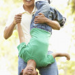 Father With Son In Park - Stock Photo