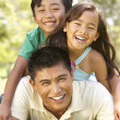 Father And Children Enjoying Day In Park - Stock Photo