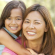 Stock Photo: Mother And Daughter Enjoying Day In Park