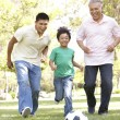 Grandfather With Son And Grandson Playing Football In Park — Stock Photo