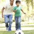Father And Son In Park With Football — Stock Photo #4822860