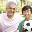 Stock Photo: Grandfather And grandson In Park With Football