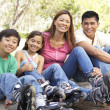Family Putting On In Line Skates In Park — Stock Photo