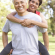 Stock Photo: Senior Couple Working Out In Park