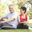 Senior Couple Resting After Exercise - Stock Photo