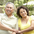 Senior Couple Relaxing In Garden Together — Stock Photo #4822996