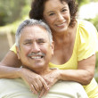 Senior Couple Relaxing In Garden Together — Stock Photo #4822997