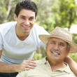 Senior MWith Adult Son In Garden — Stock Photo #4823004