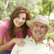 Senior Man With Adult Daughter In Garden — Stockfoto