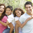 Portrait of Happy Family In Park — Stock Photo #4823021