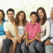 Stock Photo: Extended Family Relaxing At Home Together