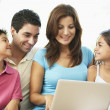 Family Sitting On Sofa At Home With Laptop — Stock Photo