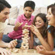 Family Playing Game Together At Home — Stock Photo #4823059