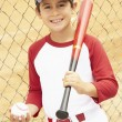 Foto de Stock  : Young Boy Playing Baseball