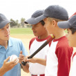 Young Boys In Baseball Team With Coach - Stock Photo