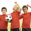 Children playing football - Stock Photo