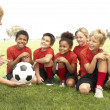 Young Boys And Girls In Football Team With Coach — Стоковое фото #4823178