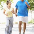 Senior Couple Jogging In Park — Stock Photo #4823240