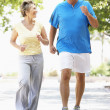 Senior Couple Jogging In Park — Stock Photo