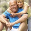 Senior Couple Exercising In Park — Stock Photo