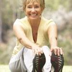 Senior Woman Exercising In Park — Stock Photo