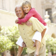 Stock Photo: Senior Couple Having Fun In City