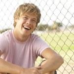 Teenage Boy Sitting In Playground — Stock Photo