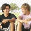 Stock Photo: Group Of Teenagers Sitting In Playground