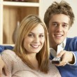 Young Couple Watching Television Together — Stock Photo