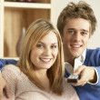 Young Couple Watching Television Together — Stock Photo #4823576