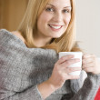 Young Woman Sitting On Sofa With Cup Of Coffee — Stock Photo