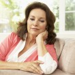 Senior Woman Relaxing In Chair At Home — Stock Photo