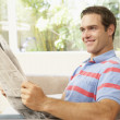 Stock Photo: MReading Newspaper At Home