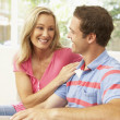Young Couple Relaxing On Sofa At Home — Stock Photo #4823811