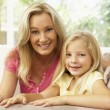 Mother And Daughter Relaxing On Sofa At Home — Stock Photo #4823833