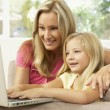 Mother And Daughter Using Laptop At Home — Stock Photo #4823836