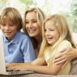 Stock Photo: Mother And Children Using Laptop At Home