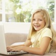 Young Girl Using Laptop At Home — Stock Photo #4823838
